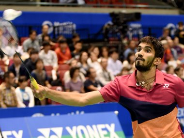 Srikanth Kidambi of India returns a shot against his compatriot Ajay Jayaram. AFP