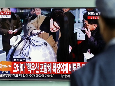 "A South Korean man watches a TV news program showing North Korean leader Kim Jong Un, at Seoul Railway Station in Seoul, South Korea, Friday, Sept. 9, 2016. North Korea said Friday it conducted a ""higher level"" nuclear warhead test explosion, which it trumpeted as finally allowing it to build ""at will"" an array of stronger, smaller and lighter nuclear weapons. It is Pyongyang's fifth atomic test and the second in eight months. The letters read "" Obama calls for serious consequences for North Korea provocations."" (AP Photo/Ahn Young-joon)"