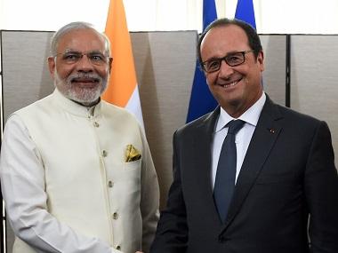 PM Narendra Modi (left) with French President Francois Hollande. AFP