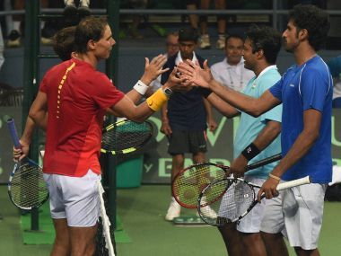 Spain's Rafael Nadal and Marc Lopez with India's Leander Paes and Saketh Myeni. PTI