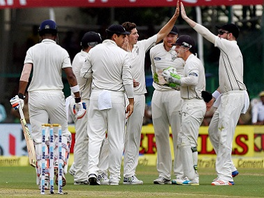 New Zealand players celebrate a wicket on day one. PTI
