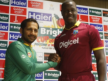 Pakistan's T20I captain Sarfraz Ahmed (left) with his West Indies counterpart Carlos Brathwaite. AFP