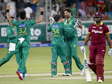Pakistan players celebrate taking a wicket during the T20I match against West Indies. AFP
