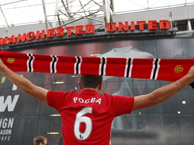 A Manchester United fan wearing a Paul Pogba t-shirt outside Old Trafford stadium. Reuters