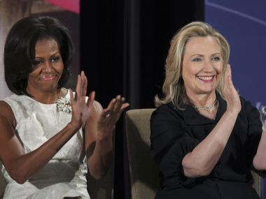 File photo of Hillary Clinton and Michelle Obama. Reuters