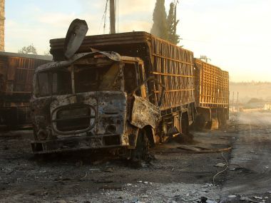 Damaged aid trucks are pictured after an airstrike on the rebel held Urm al-Kubra town, western Aleppo city, Syria. Reuters