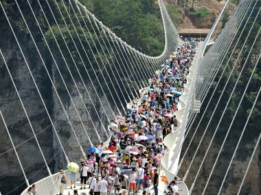 People visit a glass bridge in Zhangjiajie. Reuters