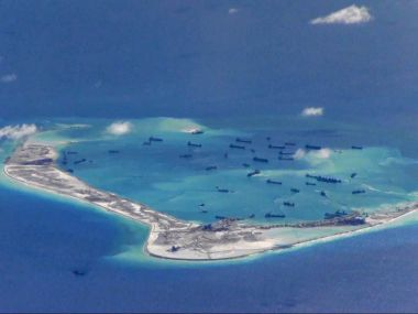 Chinese dredging vessels are purportedly seen in the waters around Mischief Reef in the disputed Spratly Islands in the South China Sea. Reuters