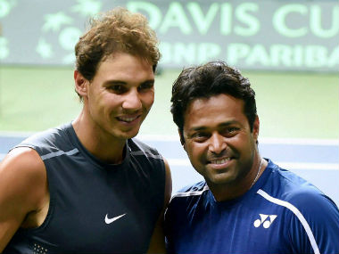 Rafael Nadal (left) with Leander Paes during a practice session in New Delhi ahead of the Davis Cup tie between Spain and India. PTI