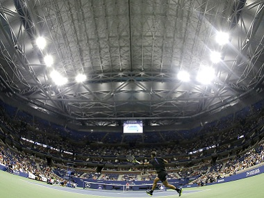 With the roof closed at Arthur Ashe Stadium, Rafael Nadal of Spain returns a shot to Andreas Seppi of Italy. AP