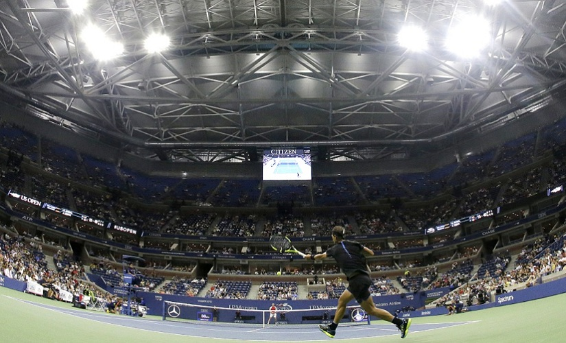 Rafael Nadal, of Spain, returns a shot against Andreas Seppi, of Italy with the roof closed. AP