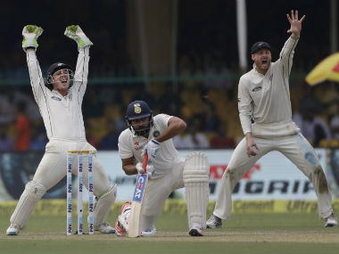 New Zealand players appeal unsuccessfully for an LBW against Rohit Sharma (centre). AP