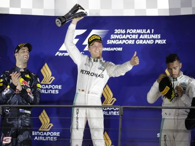 Nico Rosberg, Daniel Ricciardo, Lewis Hamilton on the Singapore GP podium. AP