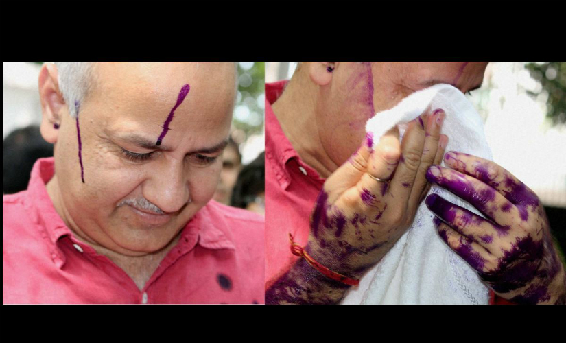 Ink being thrown at Delhi Deputy CM Manish Sisodia on Monday. PTI