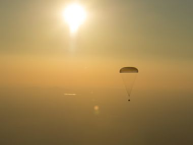 This photo provided by NASA shows the Soyuz TMA-20M spacecraft as it lands with Expedition 48 crew members NASA astronaut Jeff Williams, Russian cosmonauts Alexey Ovchinin, and Oleg Skripochka of Roscosmos. AP