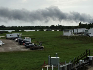 Smoke rises from SpaceX launch site. AP