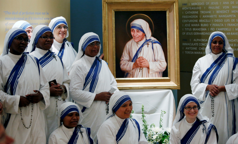 Members of Mother Teresa's order, the Missionaries of Charity, gather around the official canonisation portrait of Mother Teresa after the unveiling at the John Paul II National Shrine in Washington, US on Thursday. Reuters