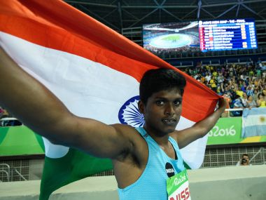 India's Mariyappan Thangavelu poses after winning gold. AFP
