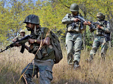Army personnel take positions and moves towards the site where militants were hiding during an encounter at Lachipora in Uri Sector of north Kashmir. PTI
