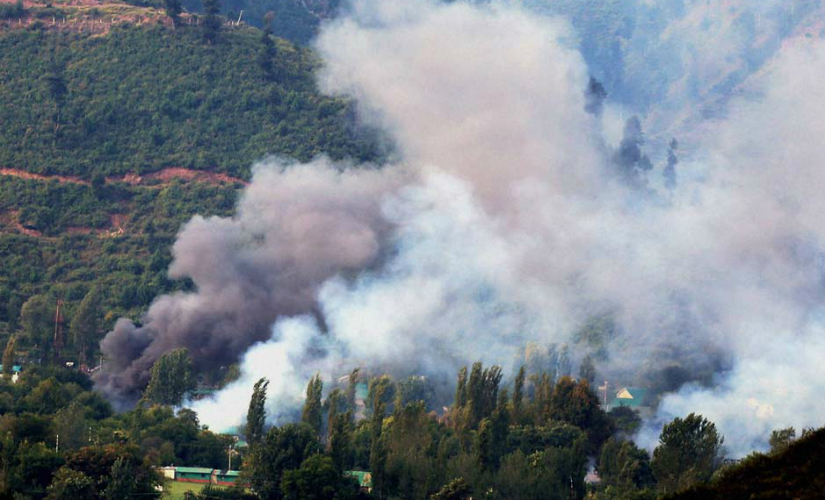 Smoke rises from the Army Brigade camp in Uri on Sunday. PTI