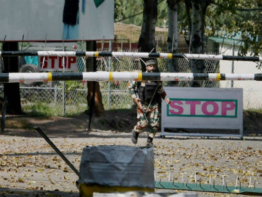Soldier outside the army camp which was attacked. PTI