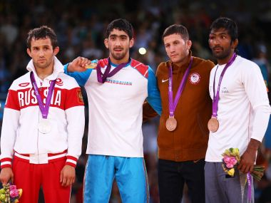 Yogeshwar Dutt on the podium at London Olympics 2012 with Toghrul Asgarov, Besik Kudukhov and Coleman Scott. Getty Images