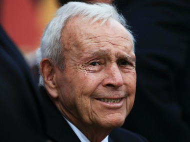 Arnold Palmer watching golf action at the Arnold Palmer Invitational Tournament. Getty Images