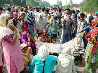 Friends and relatives mourn the passing of one of the victims of the Bijnor violence. PTI