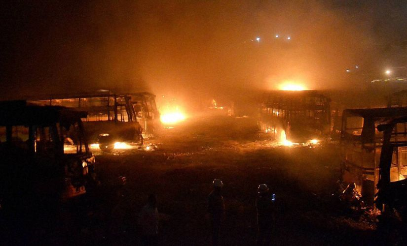 Tamil Nadu bound buses in flames after they were torched by pro-Kannada activists during a protest over Cauvery water row, in Bengaluru on Monday. PTI
