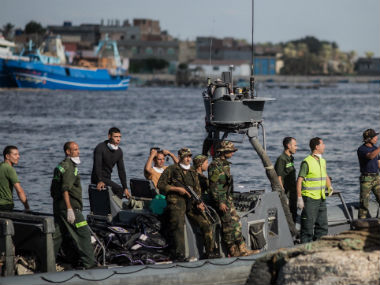 Egyptian rescue workers bringing ashore the bodies. AP