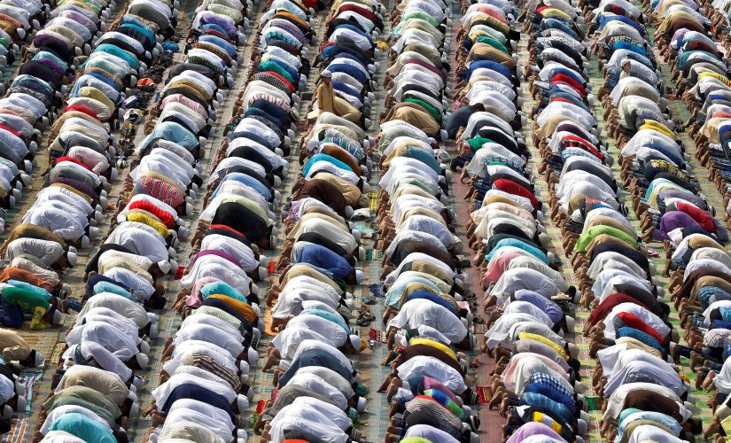People offer their Eid prayers at the Feroz Shah Kotla dargah in Delhi. Reuters