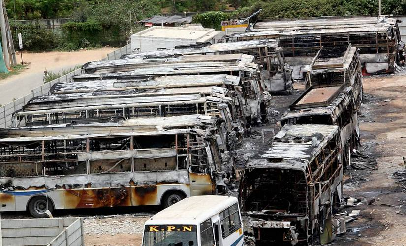 Charred remains of the buses of a private transport operator from Tamil Nadu in Bengaluru . PTI