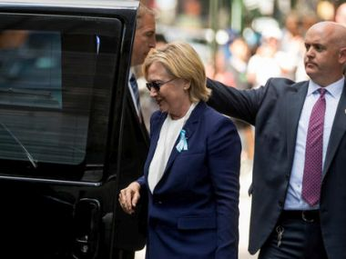 Democratic presidential candidate Hillary Clinton gets into a van as she leaves an apartment building on Sunday. AP