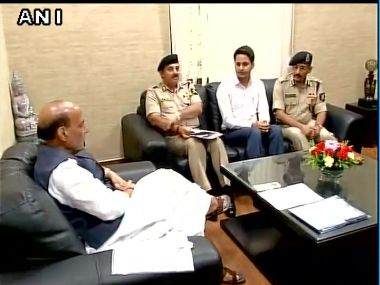 Union Home Minister Rajnath Singh meets Nabeel Ahmad Wani who topped BSF exam. Image courtesy: @ANI_news