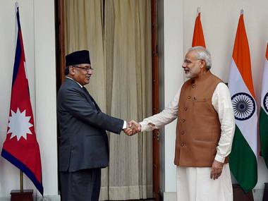 Prime Minister Narendra Modi greets Nepalese counterpart Pushpa Kamal Dahal at Hyderabad house in New Delhi on Friday. PTI