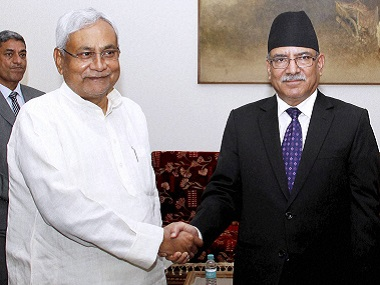 "Bihar chief minister Nitish Kumar shakes hands  with Nepal Prime Minister Pushpa Kamal Dahal ""aka Prachand""a at  a meeting in New Delhi on Thursday. PTI"