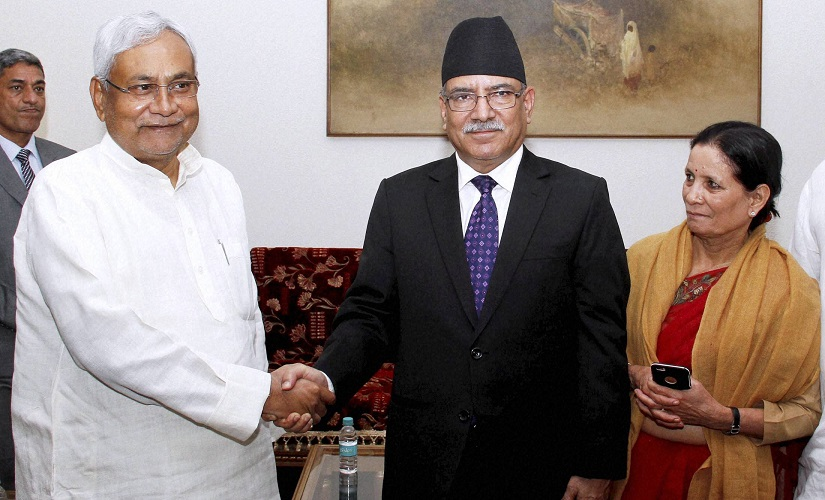 """Bihar chief minister Nitish Kumar shakes hands  with Nepal prime minister Pushpa Kamal Dahal """"aka Prachand"""" at  a meeting in New Delhi on Thursday. PTI"""