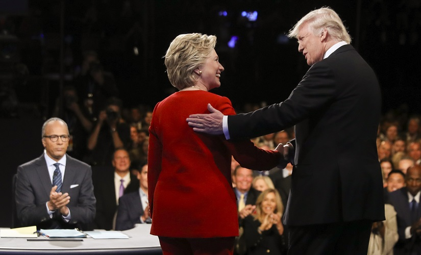 Democratic presidential nominee Hillary Clinton and Republican presidential nominee Donald Trump shake hands during the presidential debate. AP