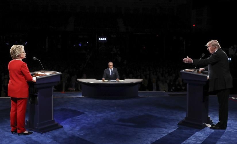 Republican presidential nominee Donald Trump points toward Democratic presidential nominee Hillary Clinton during the presidential debate at Hofstra University. AP