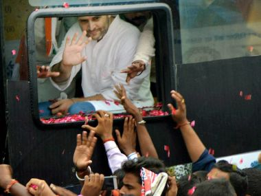 Congress vice-president Rahul Gandhi waves at supporters during a road show as part of his Kisan Yatra in Deoria on Tuesday. PTI