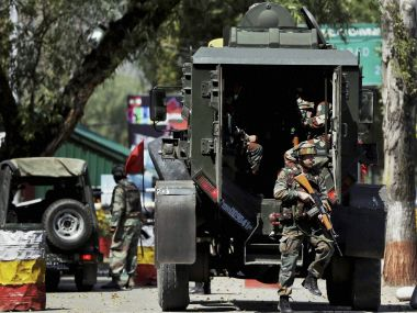 File image of Indian soldiers rushing to the attack site in Uri on Sunday. PTI