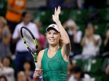 Caroline Wozniacki greets fans after defeating Agnieszka Radwanska. Reuters