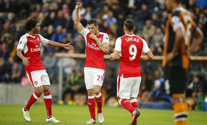 Arsenal's Mohamed Elneny (left) Granit Xhaka (centre) and Lucas Perez (right) will look to pick up some valuable minutes in Tuesday night's EFL Cup match. AP