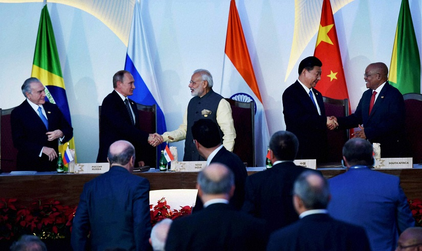 Prime Minister Narendra Modi, Brazilian President Michel Temer, Russian President Vladimir Putin, Chinese President Xi Jinping and South African President Jacob Zuma shake hands after issuing the press statement. PTI