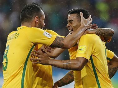 Brazil's Gabriel Jesus, celebrates with teammates after scoring a goal. AP