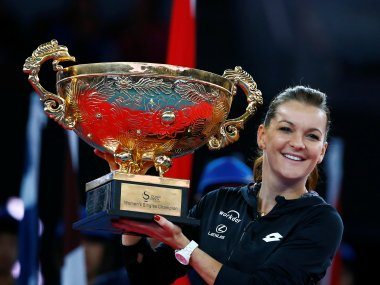 Agnieszka Radwanska holds the China Open trophy after defeating Johanna Konta. Reuters