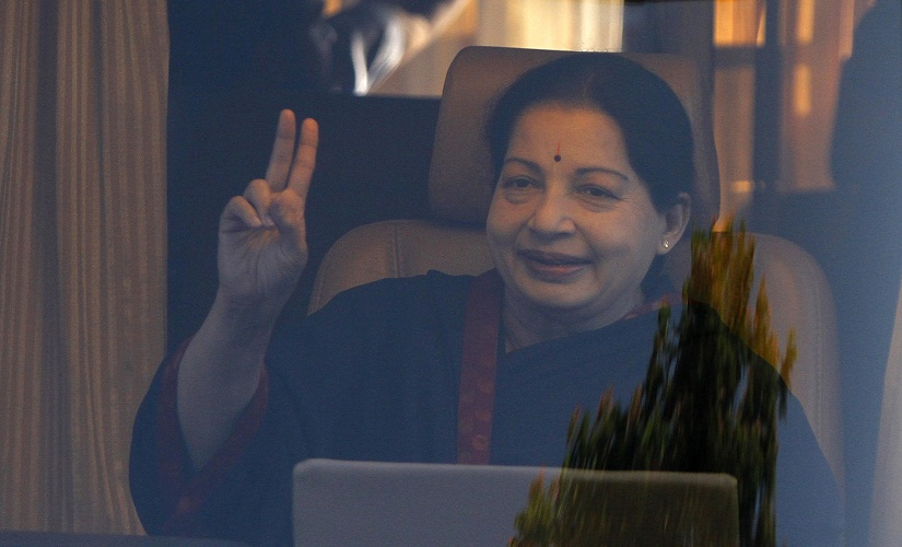 J. Jayalalithaa, chief minister of India's Tamil Nadu state and chief of Anna Dravida Munetra Khazhgam (AIADMK), gestures from inside a vehicle after addressing her party supporters during an election campaign rally in the southern Indian city of Chennai April 19, 2014. Around 815 million people have registered to vote in the world's biggest election - a number exceeding the population of Europe and a world record - and results of the mammoth exercise, which concludes on May 12, are due on May 16. REUTERS/Babu (INDIA - Tags: POLITICS ELECTIONS) - RTR3LWQ9