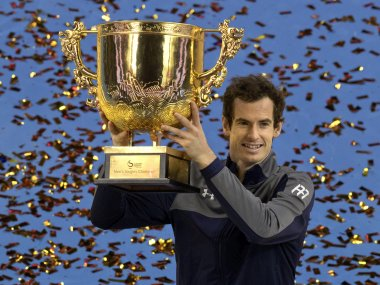 Andy Murray poses with the china Open trophy after defeating Grigor Dimitrov. AP