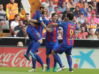 Barcelona's Lionel Messi  celebrates with team mates. Reuters