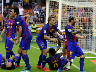 Barcelona's players incited the Valencia fans by celebrating close to them after scoring the winner. AFP